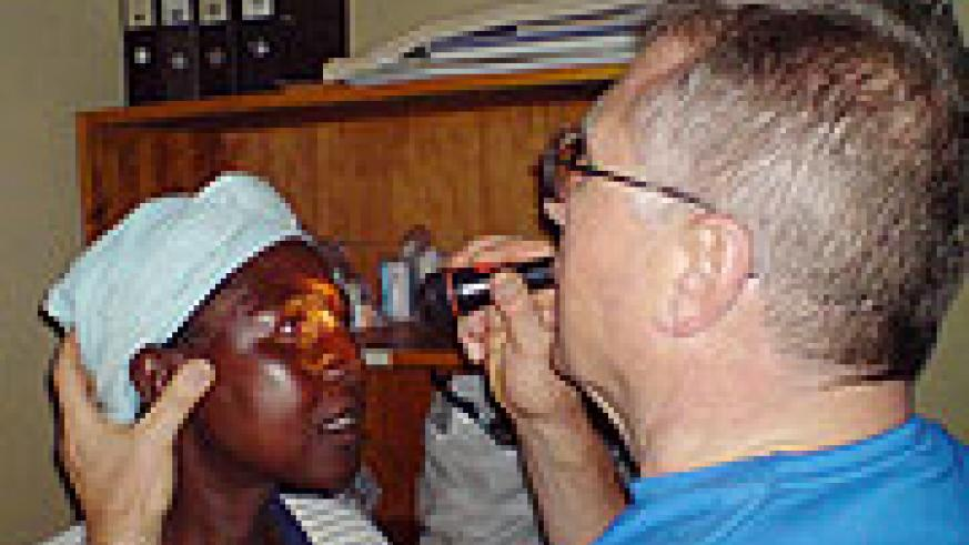 A German eye specialist examines a resident with eye defect at Ngarama Hospital in Gatsibo District early this year. (File photo)
