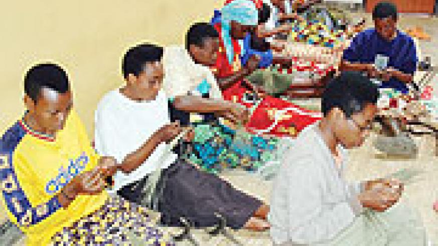 A cross section of women in Kigali City weaving baskets for export (File Photo)