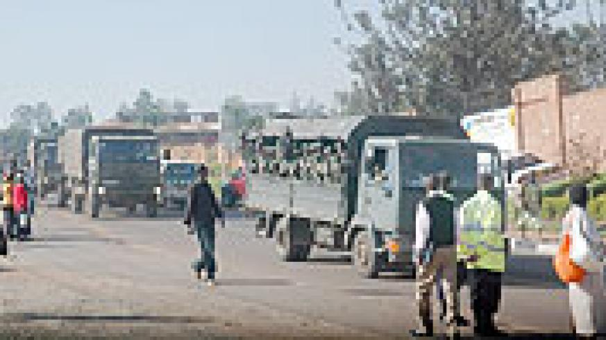 A convoy of Rwandan and Burundian Soldiers drives past Sonatubes on the way to Uganda. (Photo/ J Mbanda)