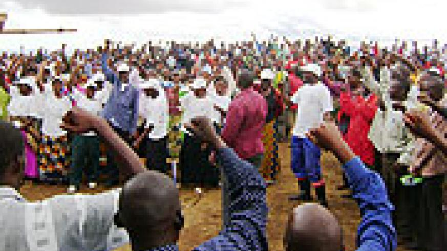 RPF supporters dance in excitement during the meeting. (Photo S Rwembeho)