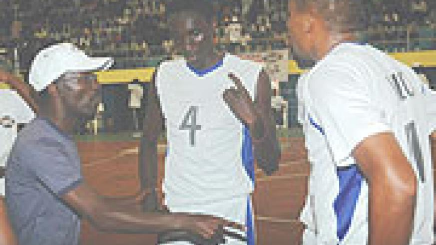 KVC players getting some tips from their coach Jean Marie Nsengiyumva during the Carre'd'AS final against APR. KVC lost the contest 2-3. (File photo)