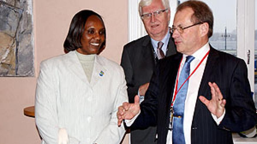 Speaker of Parliament, Rose Mukantabana shares a word with her Swedish counterpart, Per Westerberg while the Secretary General of the Swedish Parliament, Anders Forsberg looks on. (Courtesy photo)