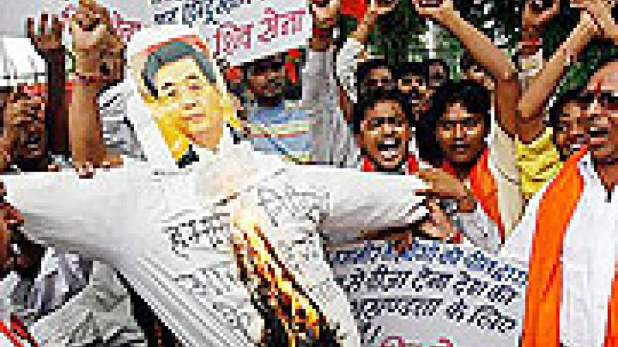 Activists of Shiv Sena, a Hindu hardline group, shout slogans as they burn an effigy of China's President Hu Jintao during a protest against the Chinese government in New Delhi.