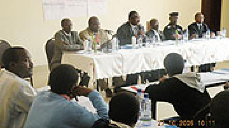 Roland Amoussouga, (centre) and other officials during the opening of the workshop.(photo/ B. Mukombozi)