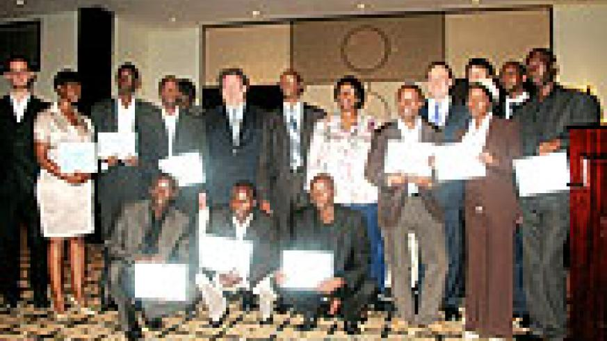 The computer programmers holding certificates, pose for a photo with their mentors, key players in ICT, World Health Organisation and the Ministry of Health
