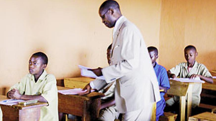 State Minister for Primary and Secondary Education, Mathias Harebamungu, distributes Examination papers.(Photo MINEDUC)