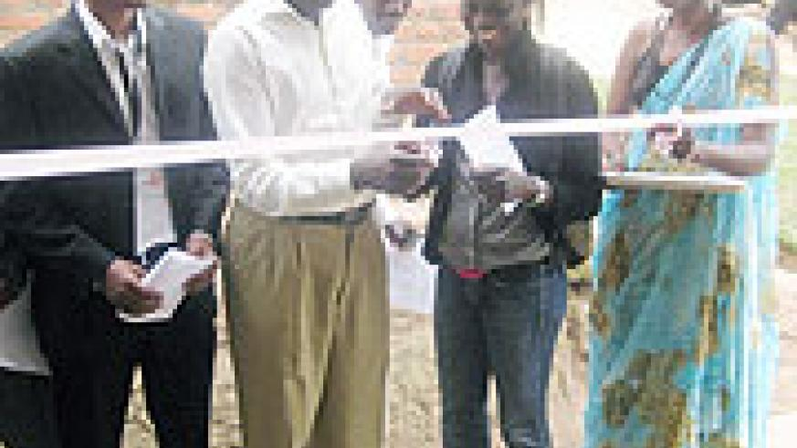 UNHCR associate field officer Mary Cisse (2nd left) cuts a tape to commission the health facility in the company of other local leaders (Photo S Nkurunziza