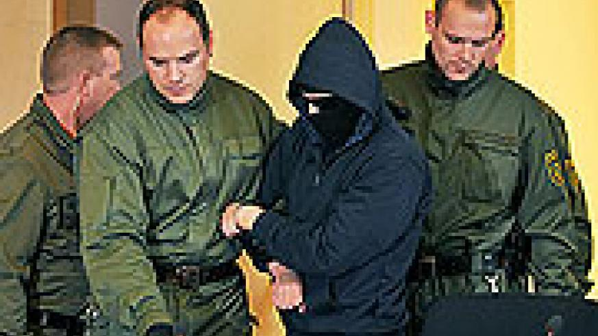 Defendant Alex W. is brought into a courtroom in Dresden on Oct. 26, 2009 on the second day of his trial for the stabbing of Marwa el-Sherbini