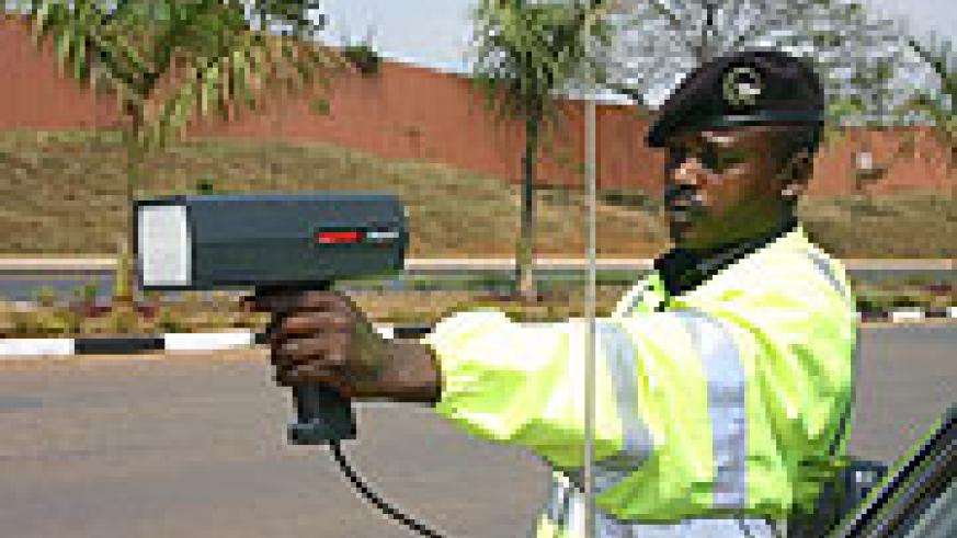 A traffic officer using a speed gun