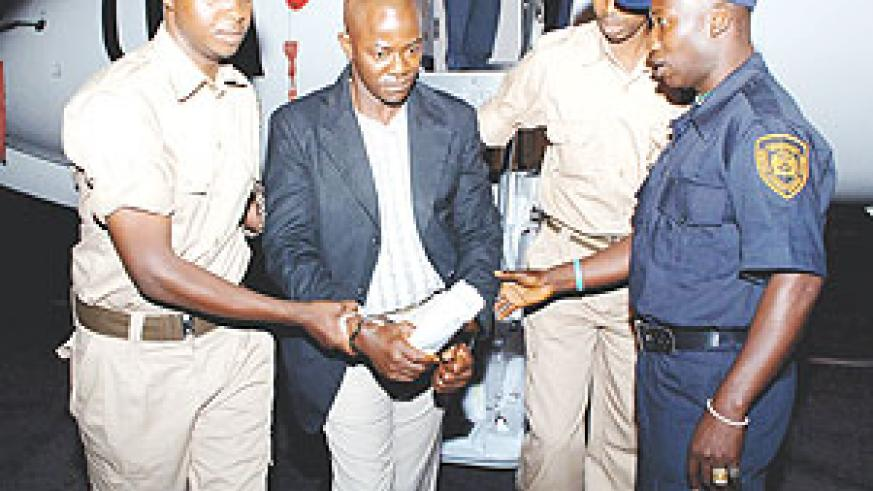 One of the convicts from the UN Special Court for Sierra Leone being handed over to Rwandan Prison security officers upon arrival at Kigali International Airport. (Courtsey Photo)