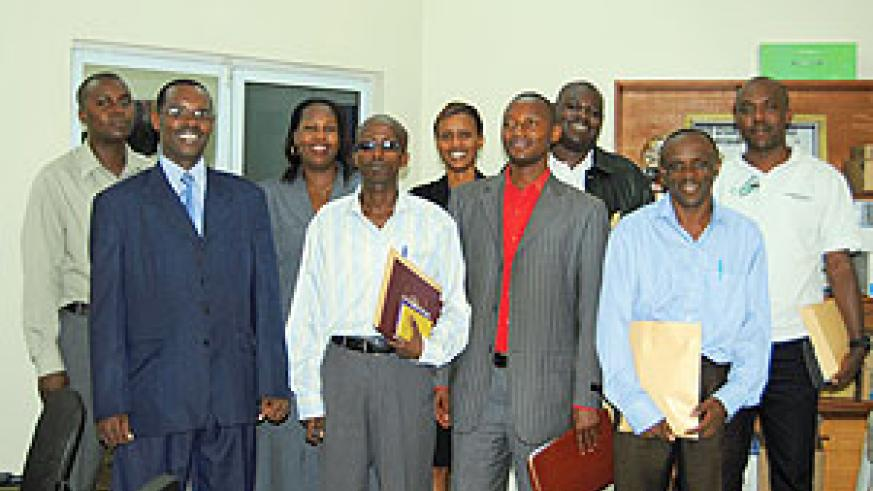 The departing trainees in a group photo with Program Coordinator Alexis Ndayisaba (L) after a briefing yesterday.
