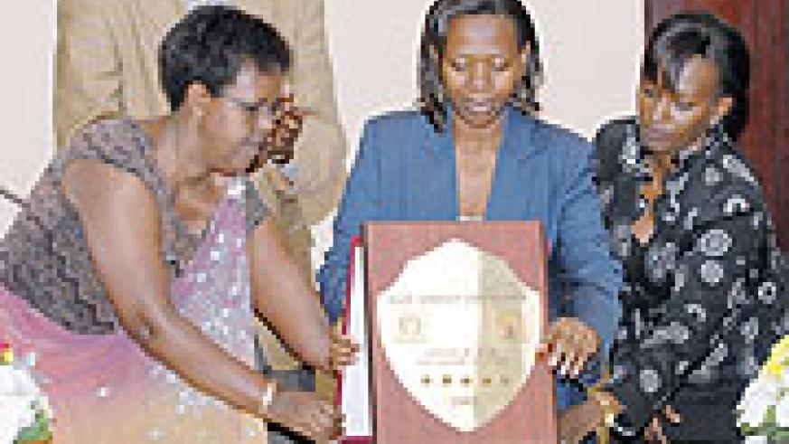 THIS IS IT: EAC's Wivine Ntamubano, Minister Monique Nsanzabaganwa and Tourism chief, Chantal Rugamba during the launch at Kigali Serena Hotel. (Photo F. Goodman)