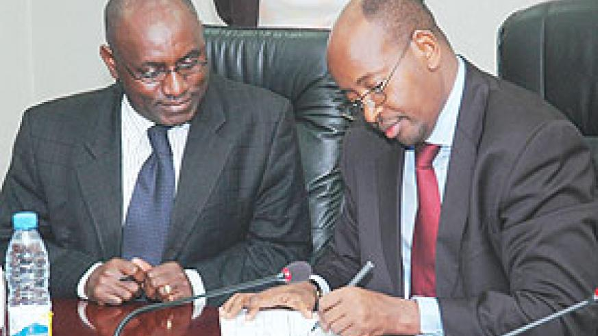 L-R: Social Security Fund Director General, Henry Gaperi, and Finance Minister, James Musoni, signing a Performance Contract on Friday.(Photo/ F Goodman)