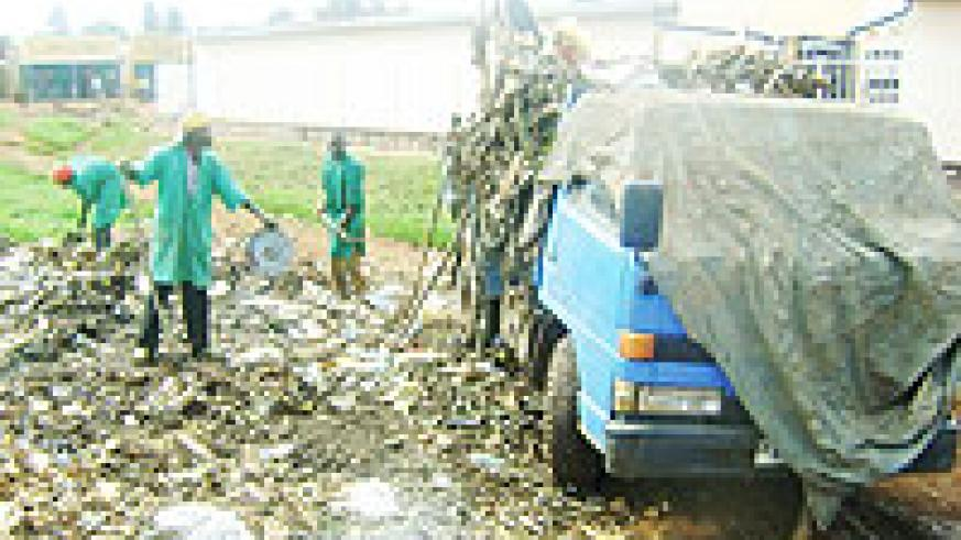 Garbage collectors in Kayonza using bare hands . (Photo / S. Rwembeho)