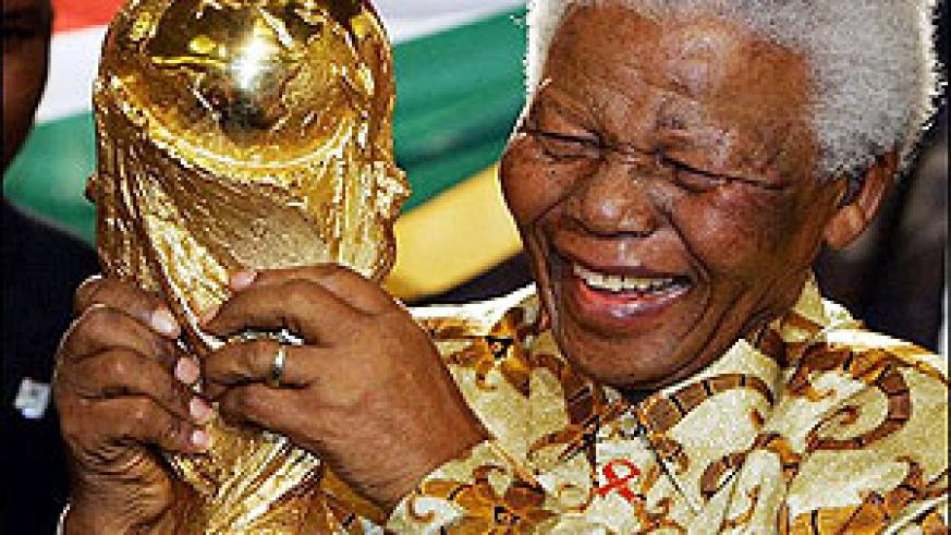 Former South African president, Nelson Mandela holding the Fifa World Cup. Rwandans shall be given the same oppertunity