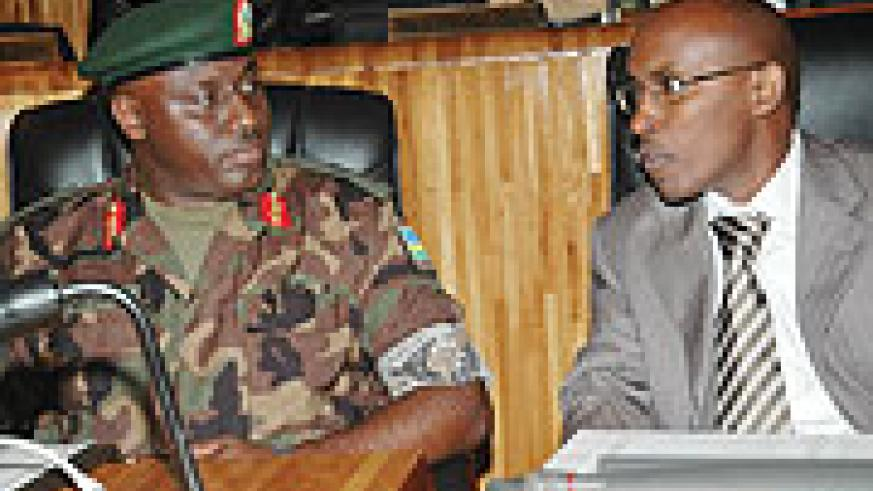 Brig.Gen. Gasana and Minister Gatare, chat in Parliament before their swearing-in. (Photo/ J. Mbanda)