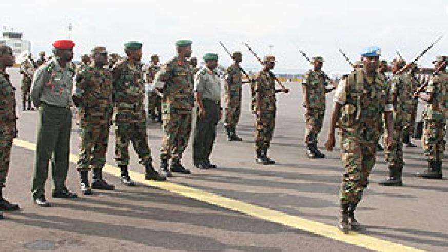 RDF troops on arrival at Kigali International Airport from their service in Darfur yesterday (Courtsey Photo)