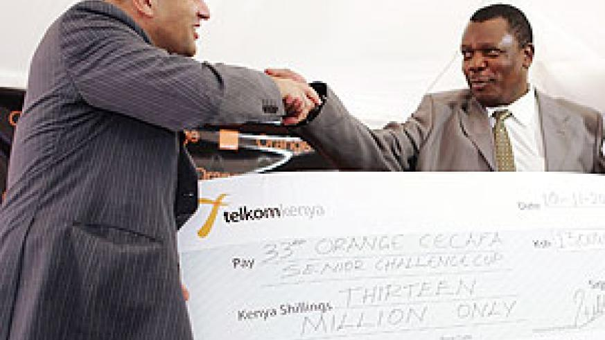Musonye (R) recieves the cheque from Orange Managing Director Mickael Ghossein.(Photo / A. Mohammed)