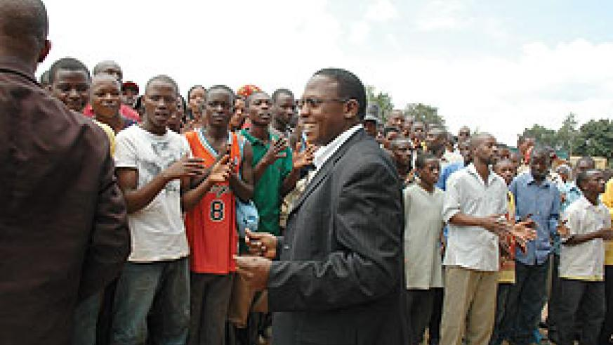 ATRACO Boss Col. (rtd)  Ludovic Twahirwa-Dodo  with association members before Friday's meeting