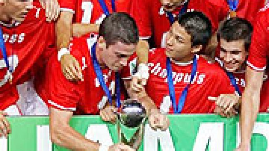 Switzerland's Soccer players react with their trophy after beating Nigeria during their U17 World Cup Final
