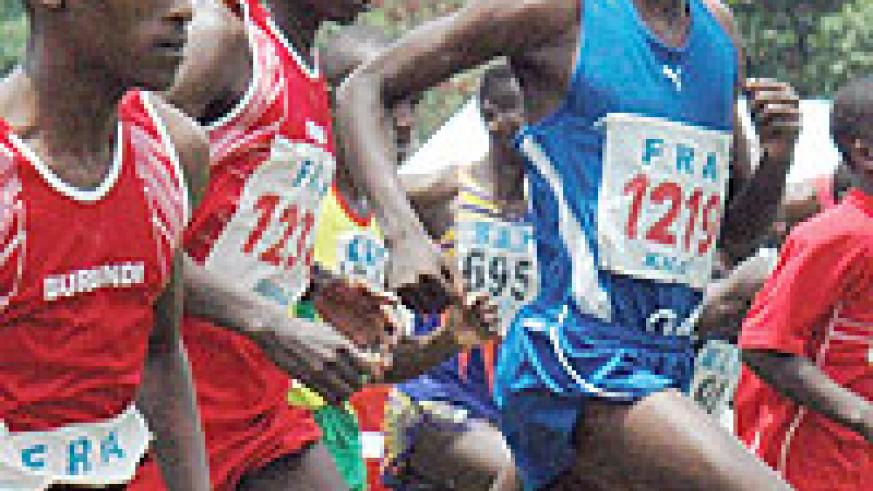 Dieudonne Disi (C) and Slyvain Rukundo (R) are Rwanda's top long and middle distance runners, both are based in Europe. (File photo)