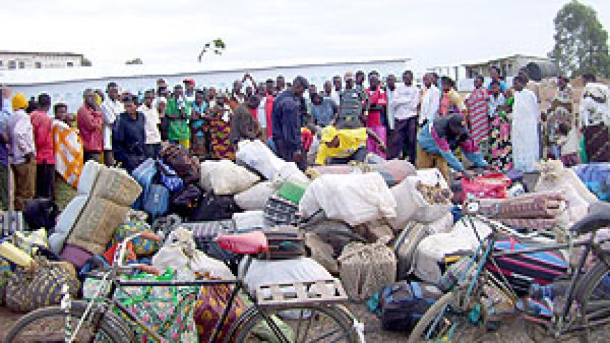 Returnees sort out their belongings at Rukomo transit camp. (File Photo)