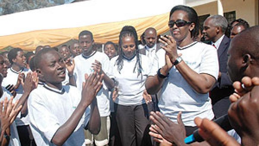 First Lady Jeannette Kagame (R) joins the youth in a song at College St. André yesterday. (Photo J Mbanda)