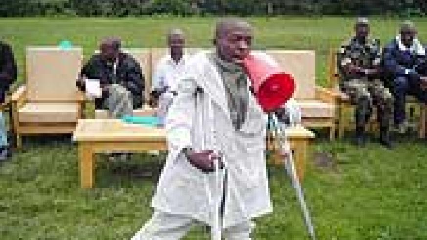 A nurse who had earlier on suffered from Polio calling upon parents to take their children for immunisation. (Photo: B. Mukombozi)