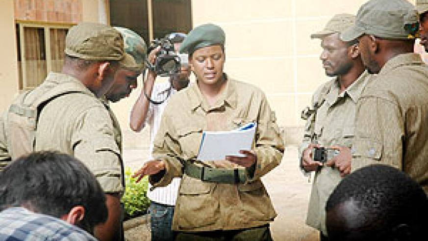 Miss Cassie Freeman (centre) giving instructions to the local film students at the scene.