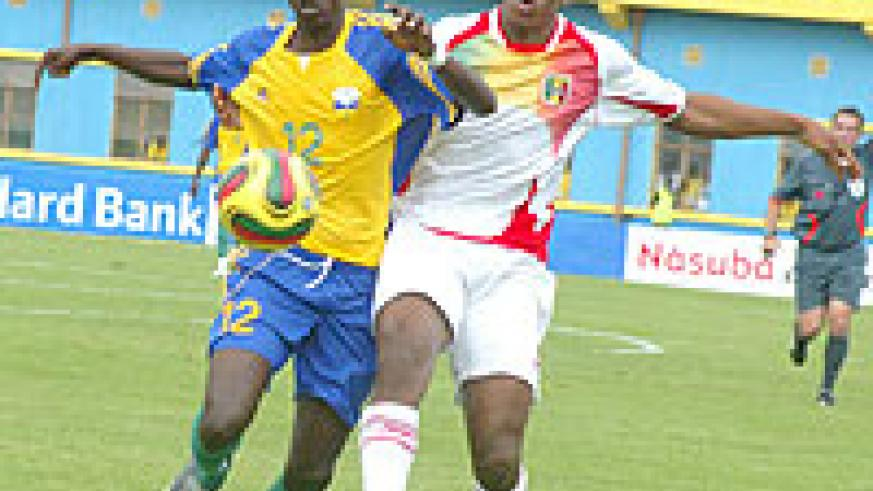 Yusuf Ndayishimiye (L) takes on a Malian player during the 2010 Africa Youth Championship. The midfielder's height and sleek passing will be crucial for Amavubi at the Orange Challenge Cup which kicks off today.