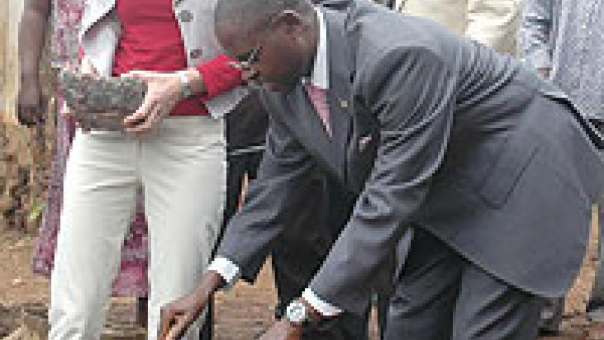 State Minister Mathias Harebamungu and DfID' Regional Chief Joy Hutcheon laying a foundation stone at the Butamwa school (Photo F Goodman)