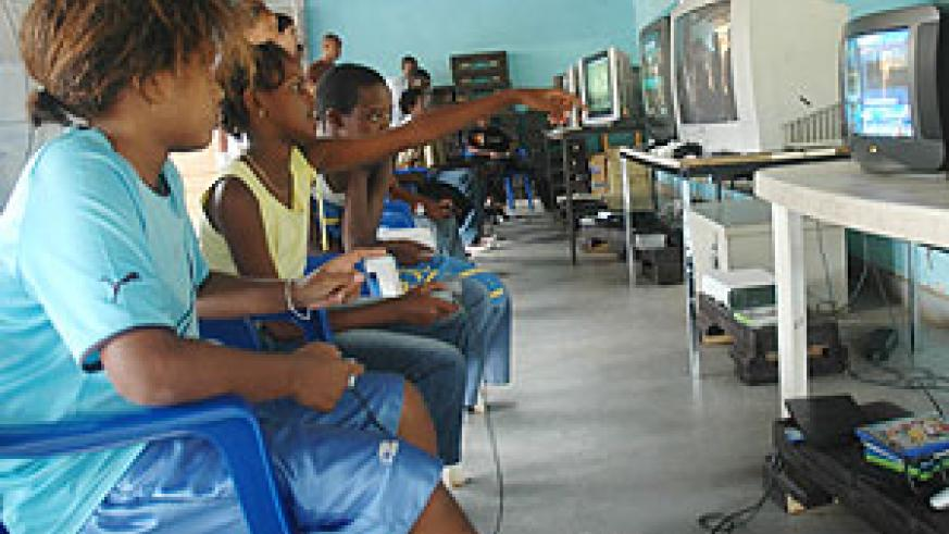 Children playing computer games at Cercle Sportif yesterday ( Photo/ F. Goodman)