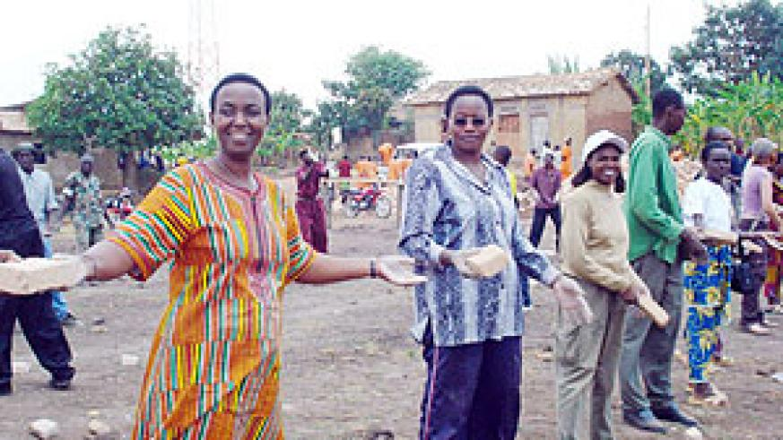Work Hard-Senator Aloysia Inyumba leads by example to construct schools blocks in Muhanga. (File photo)