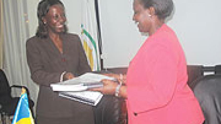 HERE YOU ARE:  Rosemary Museminali handing over to Louise Mushikiwabo