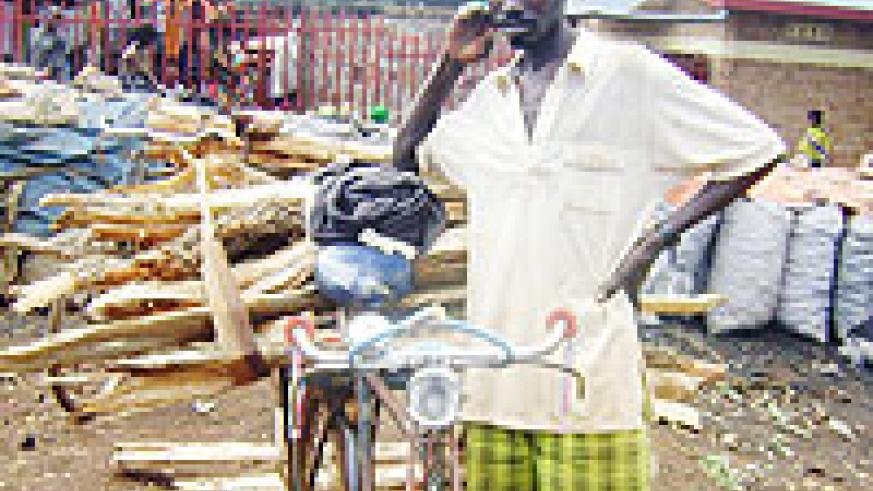 A resident selling firewood in Rwamagana market.