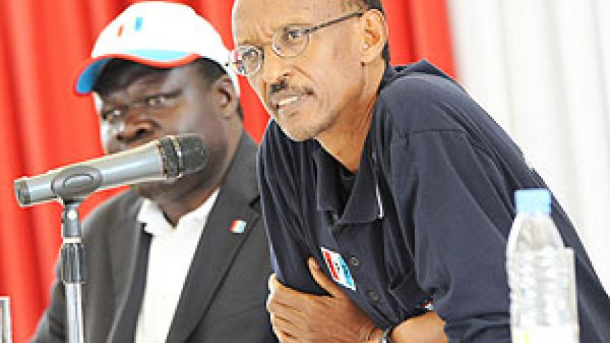 President Paul Kagame during yesterday's RPF convention at 'Petit' Amahoro Stadium.  President Kagame was re-elected Chairman of RPF while Christophe Bazivamo (left) was elected Vice Chairman of the party. (Photo Urugwiro Village )