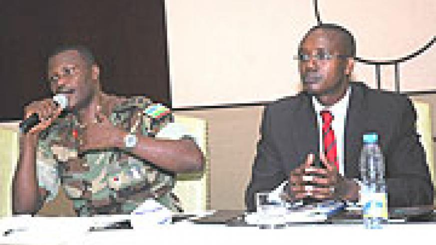 Col. Charles Karamba and Joseph Nzabamwita explain the security situation in the country to the Diaspora during the convention yesterday ( Photo by F. Goodman)