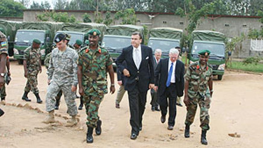 RDF Chief of staff Lt. Gen. Charles Kayonga and US Ambassador Stuart Symmington and other officials inspecting the Gako military facility that  was donated by the US. (Courtsey Photo)