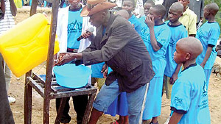 Residents and school children washing their hands using water soap. A personal and domestic hygiene campaign commences today.