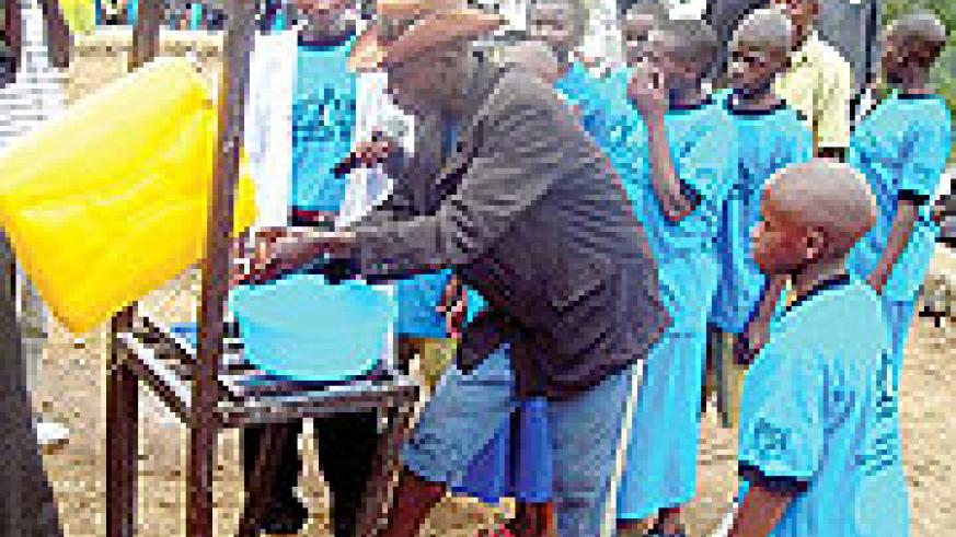 Residents and school children washing their hands using water soap. A personal and domestic hygiene campaign that commenced yesterday