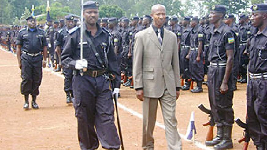 The Minister of Internal Affairs, Musa Fazil Harerimana inspects a guard of honour mounted at the police pass-out yesterday at Gishari Police Training School.(Photo/ S. Rwembeho)