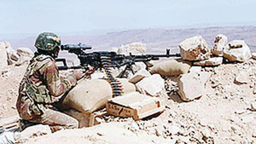 An undated handout picture obtained from the Yemeni army on November 27, 2009 shows a Yemeni soldier manning a machine gun at the battlefield in Saada province.