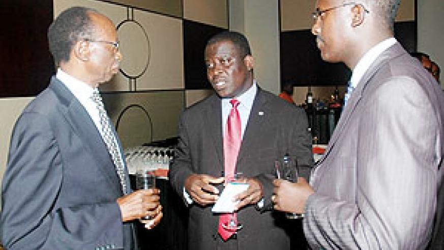 Ecobank Managing Director Daniel Sackey (C) with the Bank Board Chairman Emmanuel Ndahimana (L) and the head of Brand and Communication Patrick Masumbuko at the function. (Photo J Mbanda)