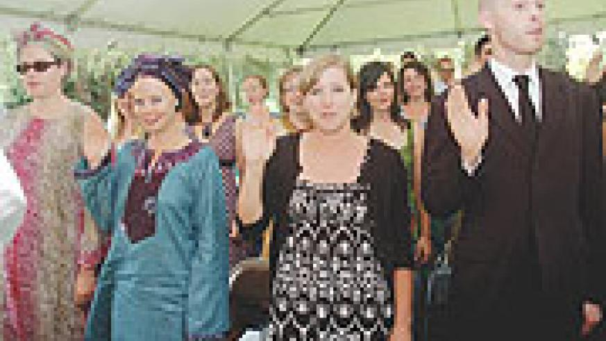 TO THE BEST OF MY ABILITY:  The Peace Corps take oath at the US Embassy Residence in Kacyiru. (Photo/ J. Mbanda)
