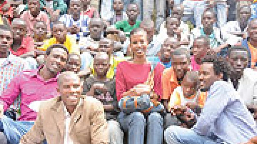 GIVING BACK:  Alpha Rwirangira, Cynthia Akazuba with street children after giving them the Christmas gifts (Photo/F. Ndoli )