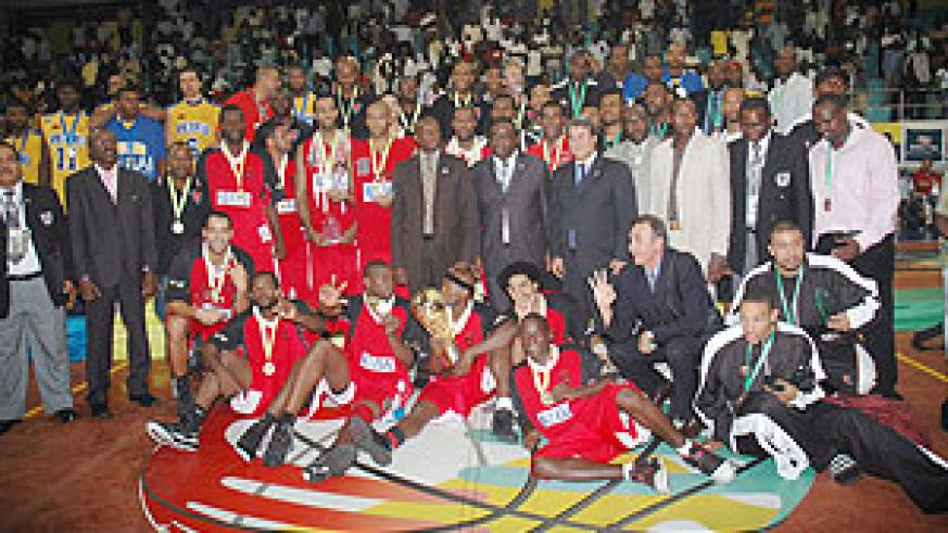 The three top teams Primeiro de Agosto, Petro Atletico and APR pose for a group with Sports minister Joseph Habineza (standing centre) and Fiba officials at the end of the ten-day championship in Kigali.