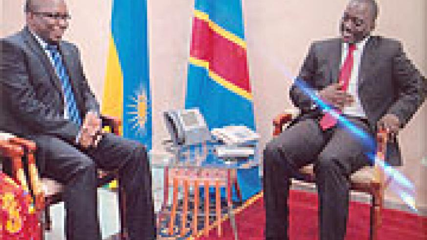 Ambassador Amandin Rugira (L) with President Joseph Kabila after the former presented his credentials. (Courtsey Photo)