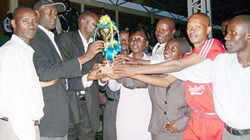 SWAA Rwanda officials hand over the trophy to Nyamabuye team. (Photo: D. Sabiiti)