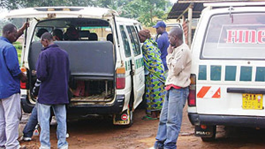 Passengers disembarking from a taxi after it was impounded by police after the driver was caught reclessly driving.