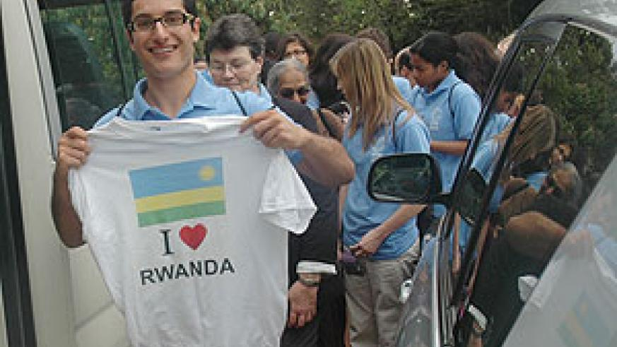LOVE AT FIRST SIGHT: A participant in the Human Rights conference displays his souvenir T-shirt. (Photo/ J. Mbanda)